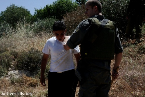 Palestinian boy held for arrest