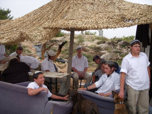 Settler youth in their 'clubhouse' on Hill 26